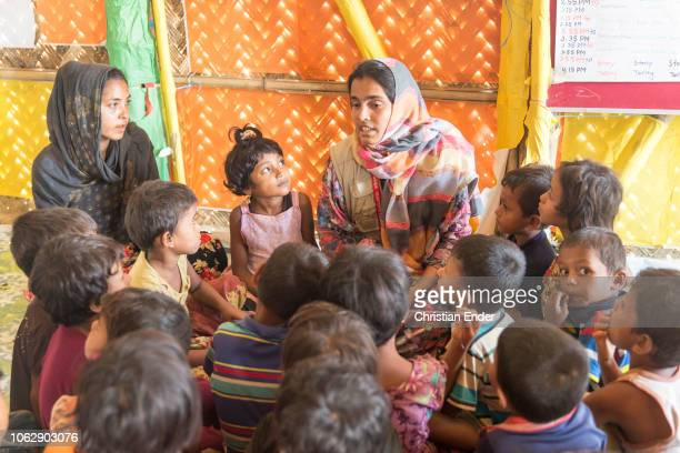 Kutupalong Ukhiya near Cox´s Bazar Bangladesh October 15 2018 A social worker paid by an NGO looks after children in the camp Refugee camp of the...