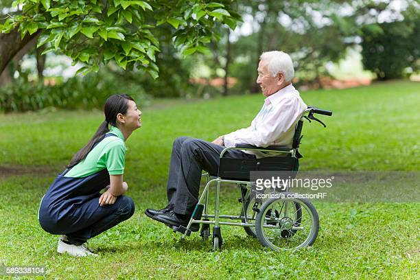 Social Worker with Senior Man on Wheelchair