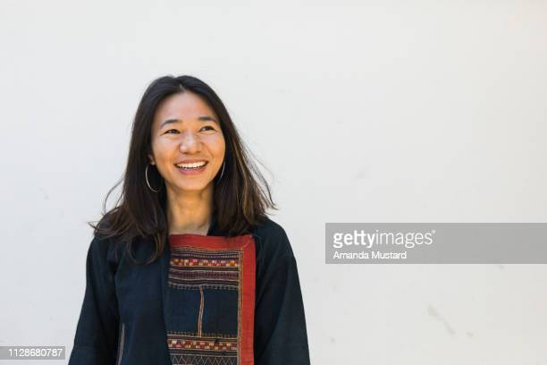 beautiful akha/thai woman smiling wearing hill tribe textile jacket - showus stock pictures, royalty-free photos & images