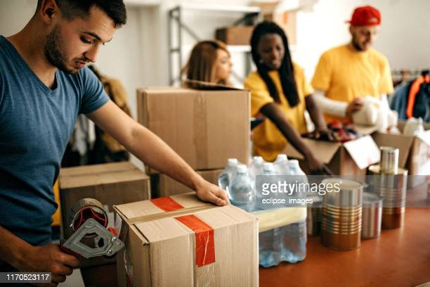 social workers - charitable donation stock pictures, royalty-free photos & images