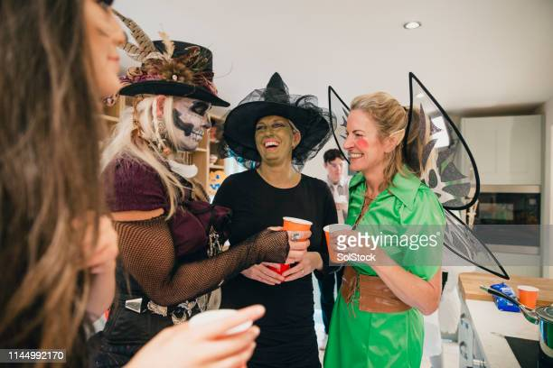 socialising in the kitchen - costume stock pictures, royalty-free photos & images