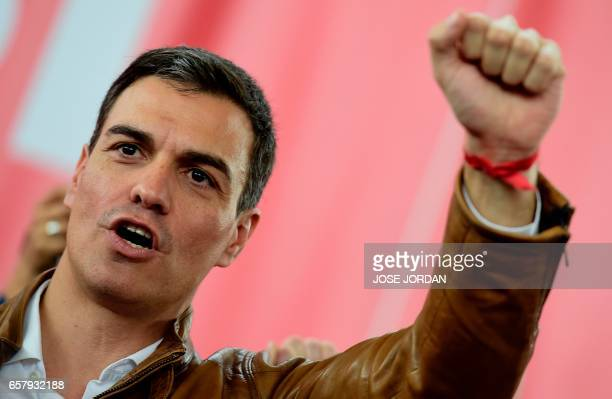 Socialist candidate for the Secretary General of the Socialist Party PSOE Pedro Sanchez raises his fist during a first campaign meeting at the sports...