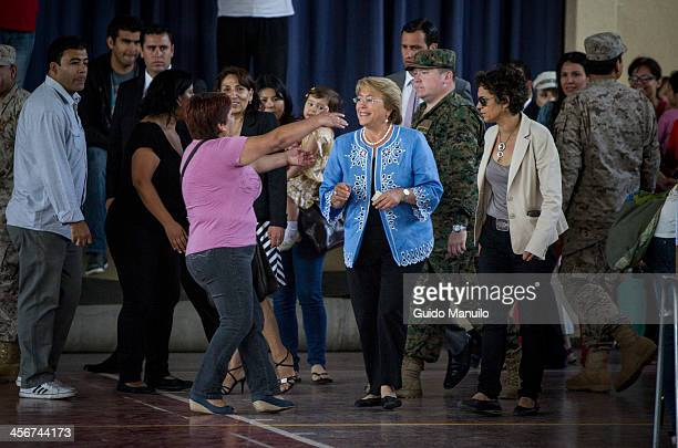 Socialist candidate Michelle Bachelet votes during the presidential ballotage in Chile between her and evelyn Matthei on December 15 2013 in Santiago...