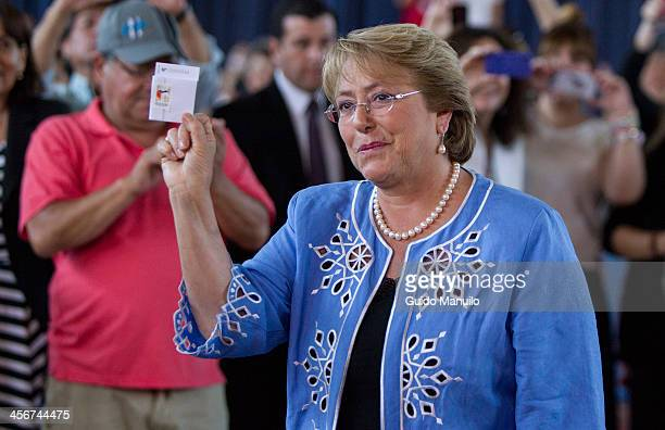 Socialist candidate Michelle Bachelet votes during the presidential ballotage in Chile between her and evelyn Matthei at Enrique Teresiano de Ossó...