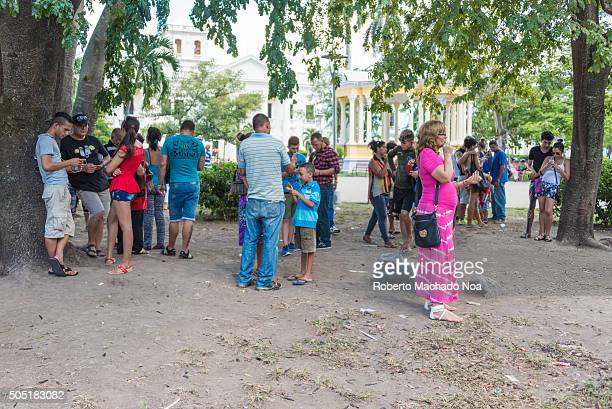 Socialist Cuba People using WiFi internet in mobile phones People travel from close towns to the place to connect to WiFi internet Cuba has...