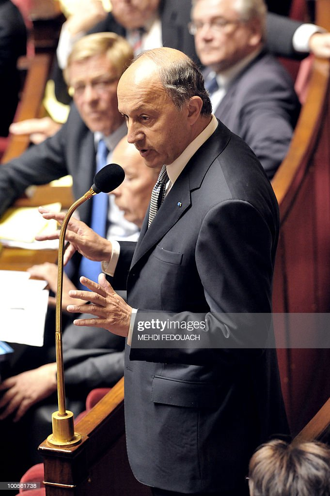 Socialist deputy and former French Prime minister Laurent Fabius adresses to Interior minister Brice Hortefeux (not in pic. ) during the session of questions to the government on May 25, 2010 at the National Assembly in Paris.