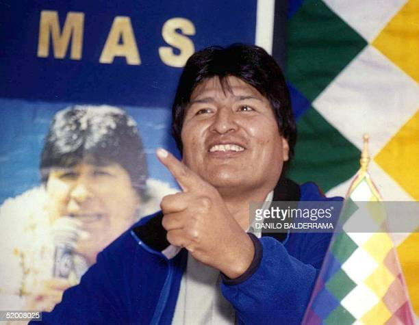 Socialist Evo Morales talks with reporters after he took a surprising second place in Bolivia's presidential vote launching him 09 July 2002 into an...