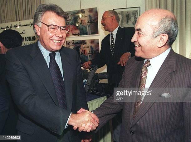 Socialist Moroccan Prime Minister Abderrahmane Youssoufi shakes hands with visiting former socialist Prime Minister Felipe Gonzalez at Sale near...