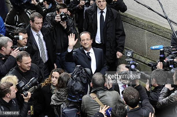 Socialist Party candidate for the 2012 French presidential election, Francois Hollande waves during a visit in a village in the neighbourhoods of...