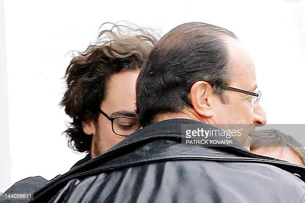 Socialist Party candidate for the 2012 French presidential election Francois Hollande talks with his son Thomas Hollande prior to give a speech...