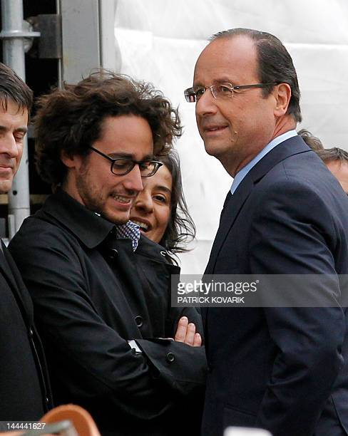 Socialist Party candidate for the 2012 French presidential election Francois Hollande stands near his son Thomas Hollande prior to give a speech...