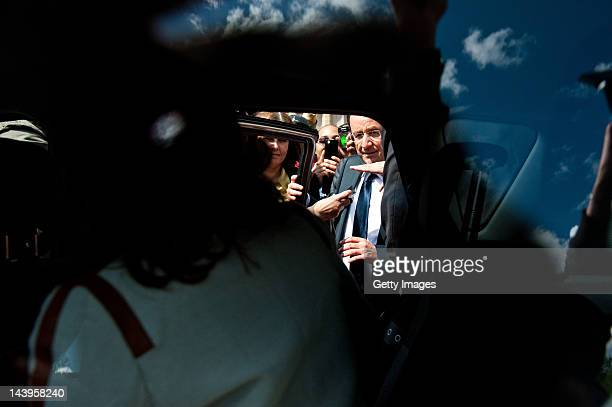 Socialist Party candidate Francois Hollande squeezes past members of the oublic to get into a car during a visit to Vigeois near Tulle with his...