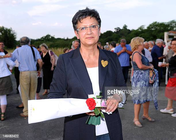 Socialist Party candidate in the 6th constituency for the French parliamentary election Sylviane Alaux poses after her victory on June 17 2012 in...