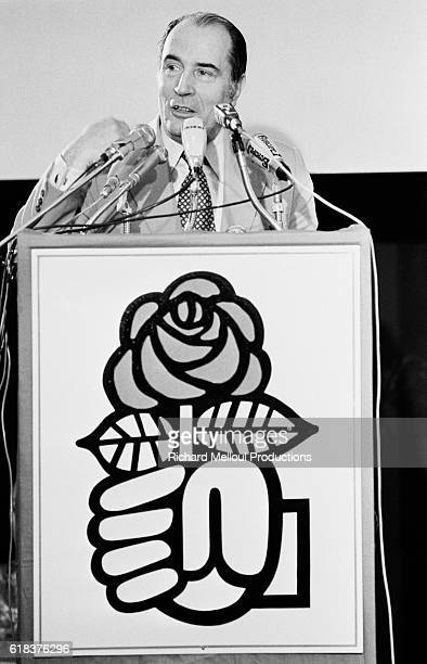 Socialist Party leader Francois Mitterrand speaks at the Palais des Sports in Paris The lectern is decorated with the symbol of the Socialist Party a...