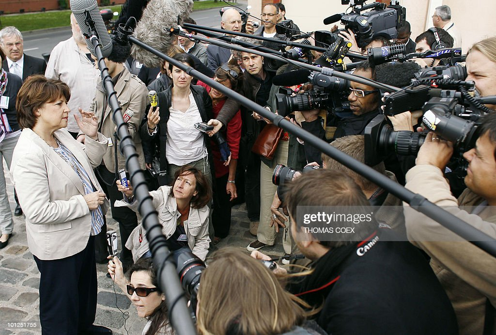 Socialist party leader Martine Aubry (L) adresses the media as she arrives to the French Socialist Party national convention on May 29, 2010 in La plaine Saint Denis, outside Paris. Aubry criticized on May 26, 2010 the government plans to raise the retirement age from the current 60 years as 'not only unfair but ineffective.'
