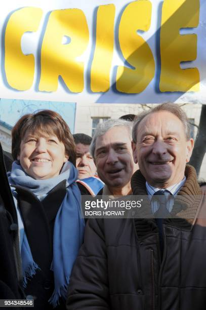 Socialist party members first secretary Martine Aubry senator Claude Bartolone and Paris' mayor Bertrand Delanoe take part in a demonstration in...