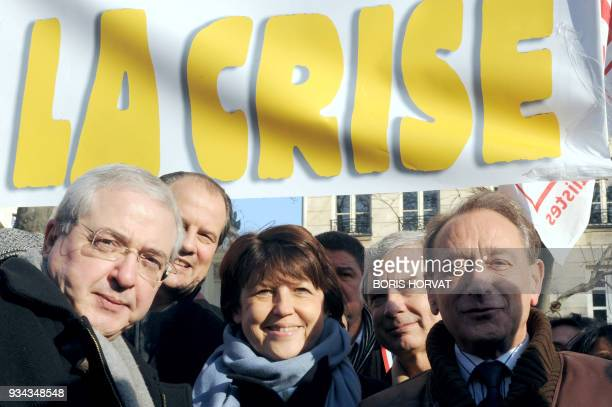 Socialist party members IledeFrance regional council president JeanPaul Huchon Ps first secretary Martine Aubry socialist senator Claude Bartolone...