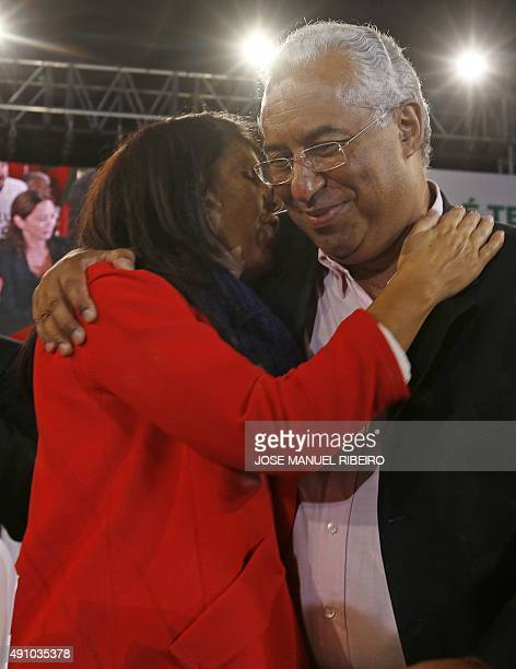 Socialist Party Secretary General Antonio Costa listens to his wife Fernanda Tadeu at the end of his last campaign rally in Lisbon on October 2 ,...