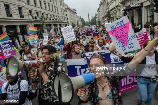 Socialist Worker Party members attend in support as thousands attend the Reclaim Pride march on July 24, 2021 in London, England.