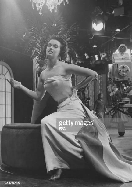 Socialite, actress and fashion designer Gloria Vanderbilt on a television set circa 1958.