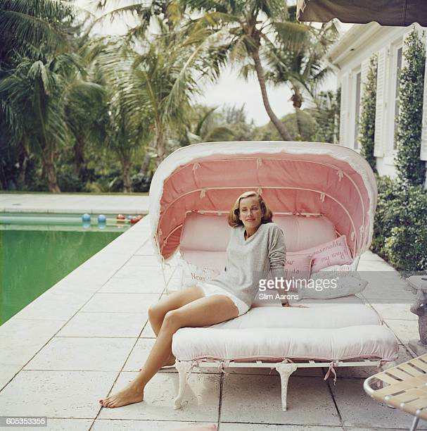 Socialite Alice Topping relaxing by a swimming pool in Palm Beach Florida 1959