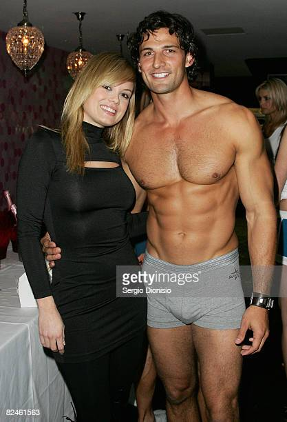 Socialite Amy Erbacher poses with a model during the official launch of Australian cricketer Brett Lee and Bruno Schiavi of AceStar underwear range...