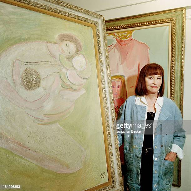 Socialite and heiress Gloria Vanderbilt is photographed for Town & Country Magazine with her paintings 'Mother and Child' and 'Pink' on December 20,...