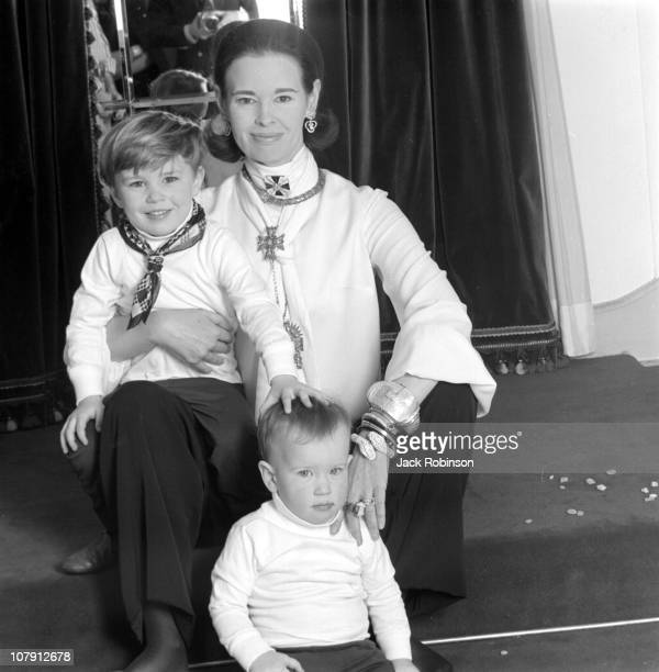 Socialite and heiress Gloria Vanderbilt poses for a portrait session with her sons Anderson Cooper and Carter Vanderbilt Cooper in their home in...