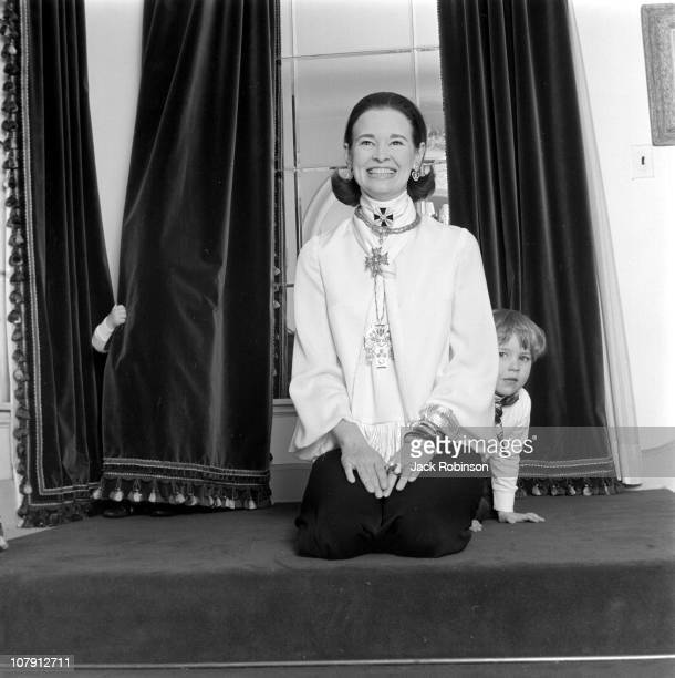 Socialite and heiress Gloria Vanderbilt poses for a portrait session with her son Carter Vanderbilt Cooper in their home in circa 1969 in...