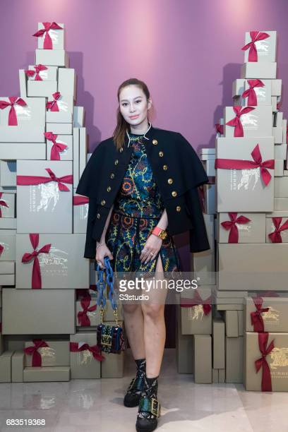 Socialite and Hong Kong billionaire Peter Lam's daughter Elly Lam poses for a photograph on the red carpet at the Burberry Pacific Place event on 03...