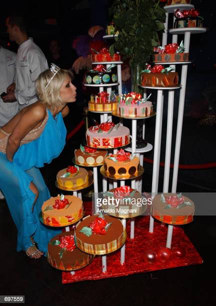 Socialite and hotel heiress Paris Hilton blows out candles at her 21st birthday party at Studio 54 February 13 2002 in New York City