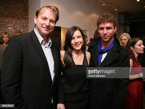 Socialite Ben Widdecombe poses with Sloane Crosley and Timo Weiland at the celebration of Sloane Crosley's I Was Told There'd Be Cake at Helmet Lang...