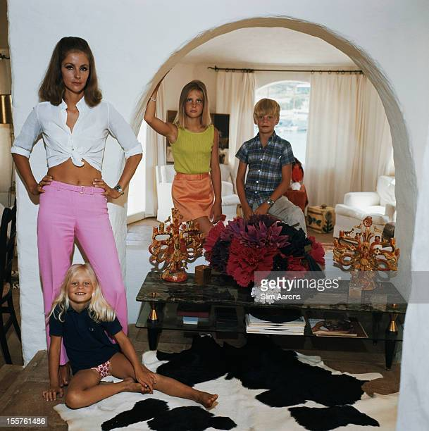 Socialite Dolores Guinness poses with two young girls and a young boy at her residence in Porto Cervo Sardinia Italy 1967