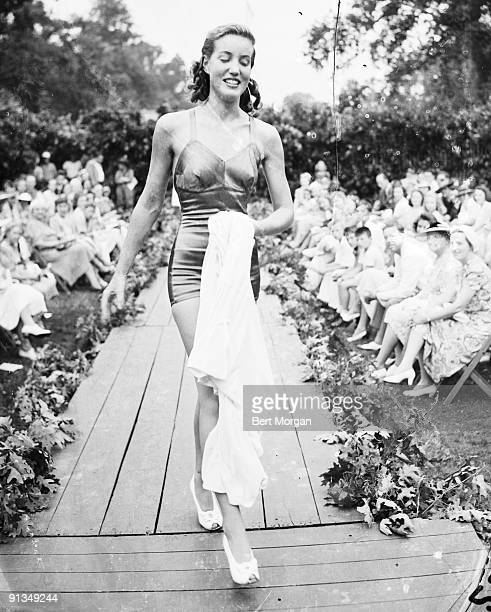 Socialite Edith Beale modeling a bathing suit on a runway in the Easthampton Fair Fashion Show Easthampton NY July 29 1940