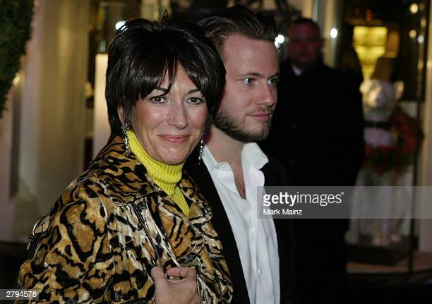Socialite Ghislane Maxwell with an unidentified male companion attends the Opening of the Asprey Flagship Store on 5th Avenue December 8, 2003 in New...