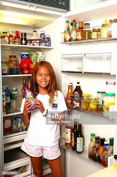 Socialite Helen Lee Schifter daugther Storey Schifter photographed near her mother's refrigerator at her home on August 13 2005 in Southampton NY