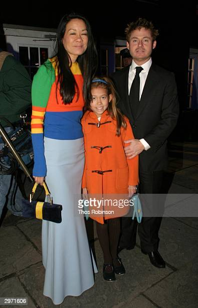 Socialite Helen Lee Schifter her Daughter Storey Schifter and Husband Peter Schifter attend Olympus Fashion Week at Bryant Park February 11 2004 in...