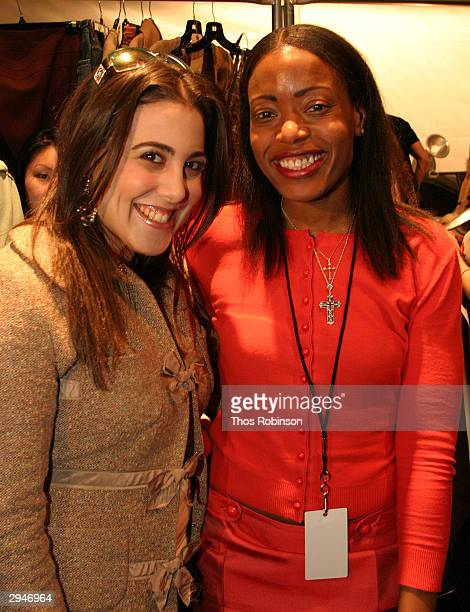 Socialite Jaime Gleicher and Designer Tracy Reese pose backstage during Olympus Fashion Week at Bryant Park February 8 2004 in New York City
