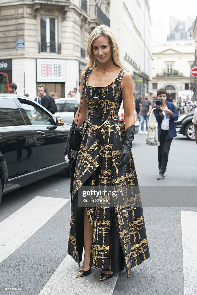 Socialite Lady Victoria Harvey wears a Vivienne Westwood dress on day 5 of Paris Fashion Week Spring/Summer 2014, Paris September 28, 2013 in Paris, France.