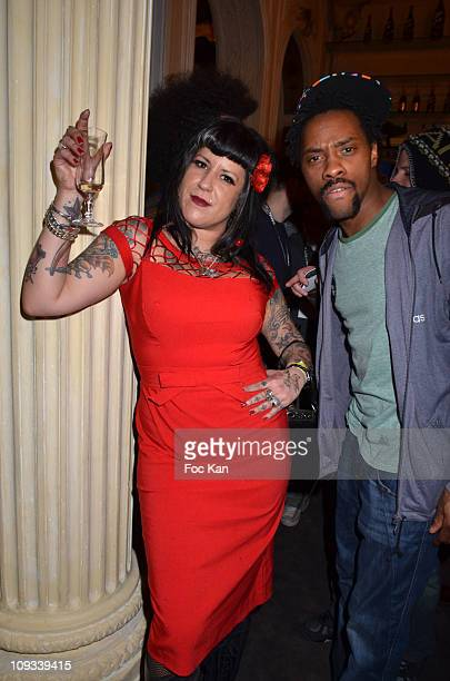 Socialite Miss Vegas and rap artist Patrick Biyik from 'Twin Twin' band attend the 'Canal Street' Concert Party at Cafe Carmen on January 26, 2011 in...