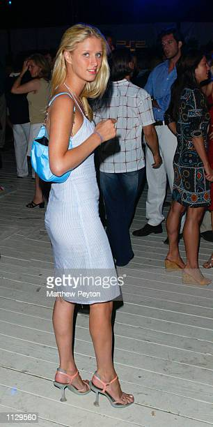 Socialite Nicky Hilton attends the Cynthia Rowley Summer Men's Fashion Show 'Suds and Studs' June 29 2002 in Sag Harbor New York The show debuted...