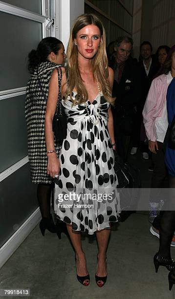 Socialite Nicky Hilton poses at the Gagosian Gallery opening reception for Julian Schnabel's exhibition of recent paintings on February 21 2008 in...