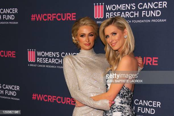 "Socialite Nicky Hilton Rothschild and sister Paris Hilton attend the Women's Cancer Research Fund's ""An Unforgettable Evening"" benefit gala at the..."