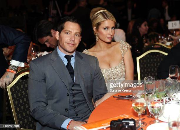 Socialite Paris Hilton and Cy Waits attend the 18th Annual Race to Erase MS event cochaired by Nancy Davis and Tommy Hilfiger at the Hyatt Regency...
