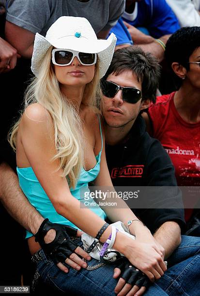 Socialite Paris Hilton and fiance Greek shipping heir Paris Latsis are seen front of stage as Madonna performs at Live 8 London in Hyde Park on July...