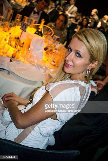 Socialite Paris Hilton photographed at the amfAR Cinema Against AIDS gala, for Paris Match on May 24 in Cap d'Antibes, France.