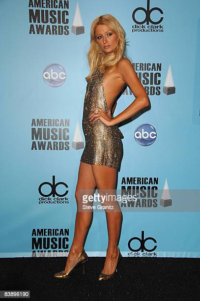Socialite Paris Hilton poses in the press room during the 2008 American Music Awards held at Nokia Theatre LA LIVE on November 23 2008 in Los Angeles...