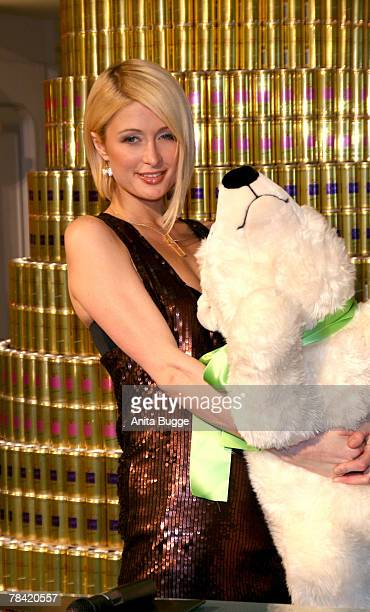 Socialite Paris Hilton poses with a stuffed polar bear before signing autographs at the KaDeWe department store to promote RICH Prosecco on December...