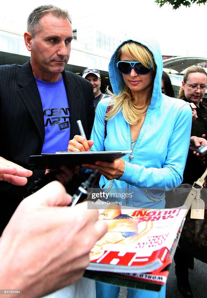 Socialite Paris Hilton signs autographs as she arrives at Melbourne Airport on December 29, 2008 in Melbourne, Australia.