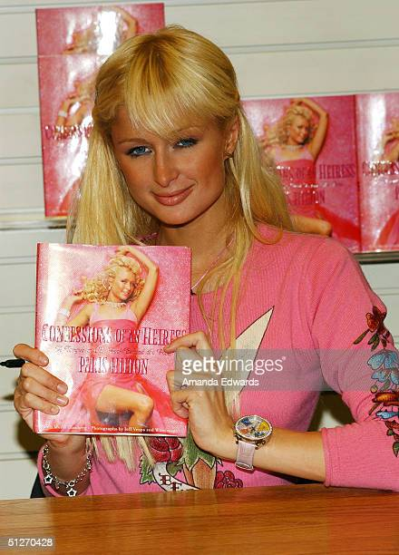 """Socialite Paris Hilton signs copies of """"Confessions Of An Heiress"""" on September 7, 2004 at Brentano's Bookstore at Westfield Shoppingtown Century..."""